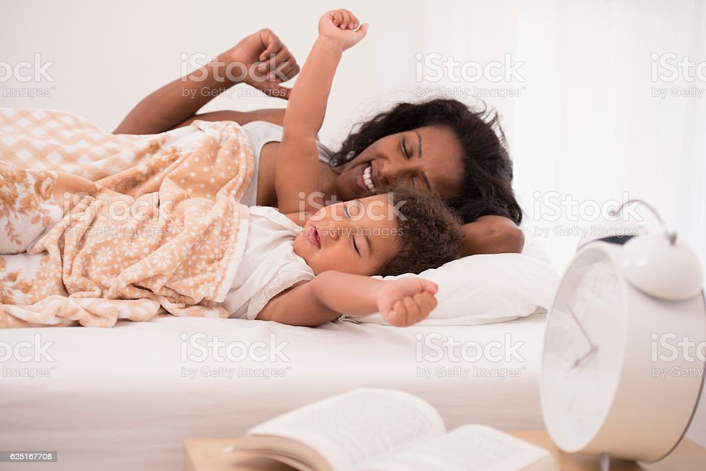 Mother and daughter in the bed. stock photo