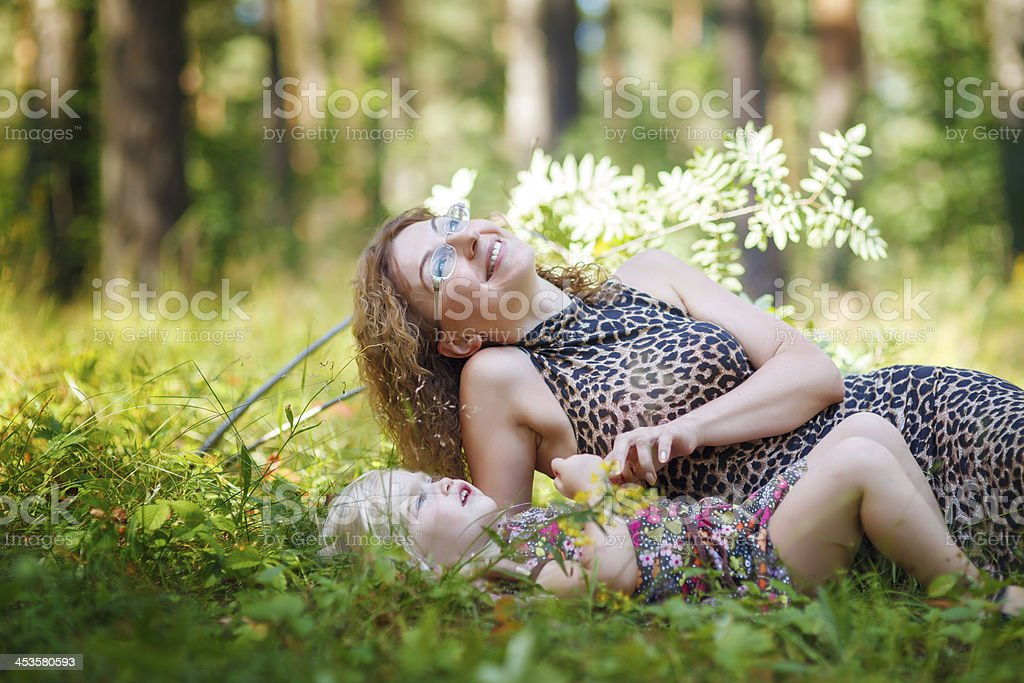 Mother and daughter in the forest royalty-free stock photo