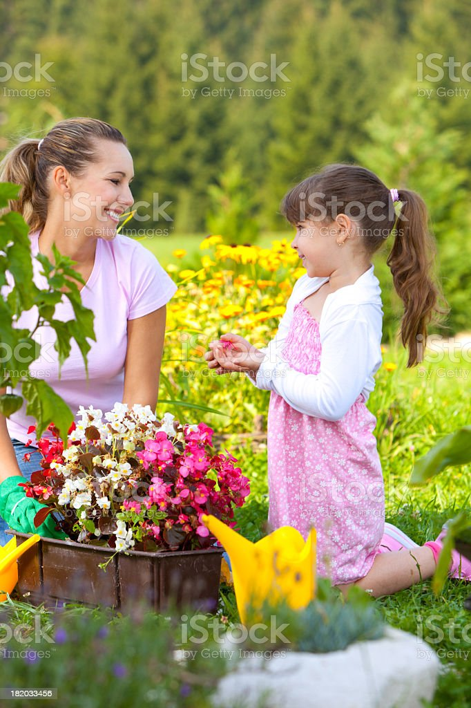 Mother and daughter in the garden stock photo