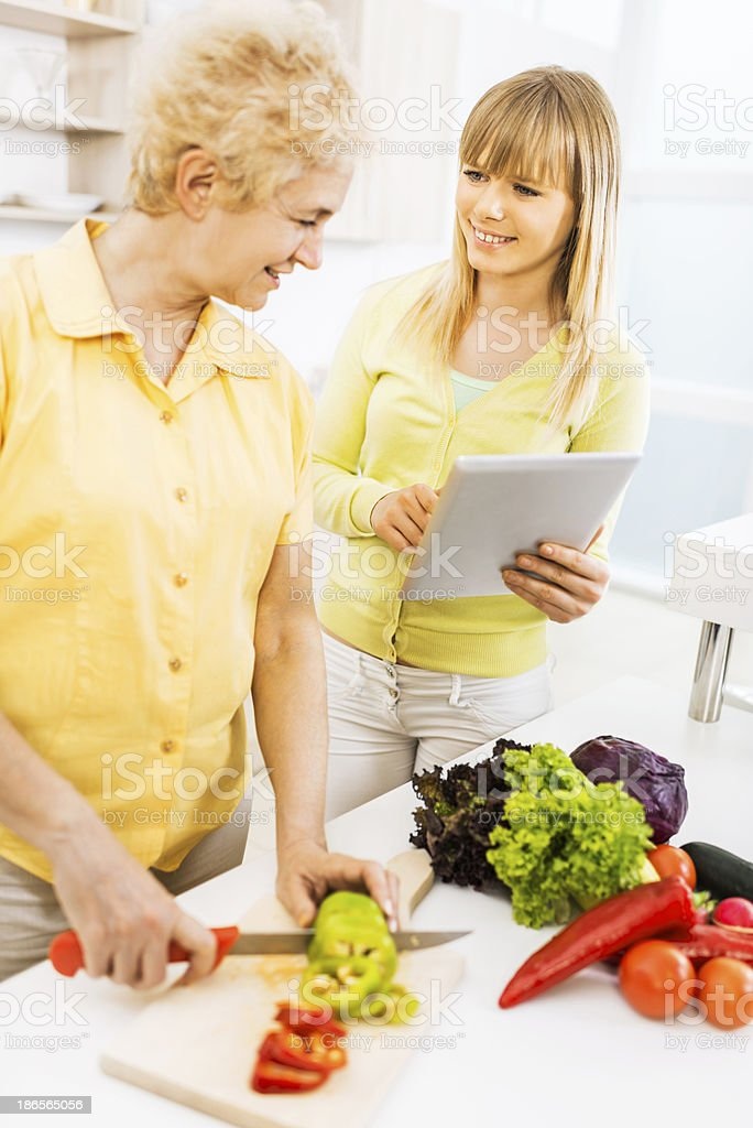 Mother and daughter in the kitchen. royalty-free stock photo