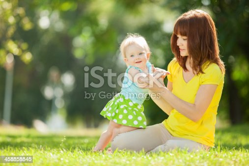 istock Mother and daughter in the park 458858845