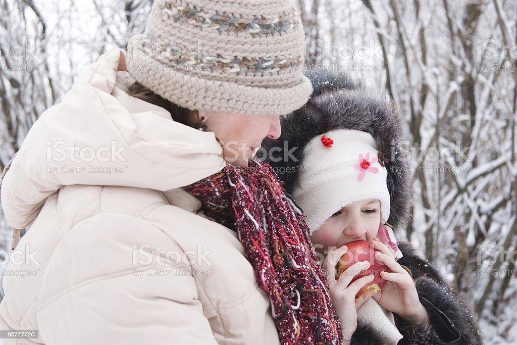 mother and daughter in winter royalty-free stock photo