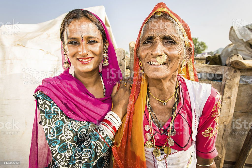 Mother and her young daughter together in traditional indian clothes....