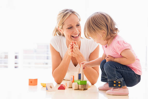 Mother and daughter indoors  2 3 years stock pictures, royalty-free photos & images