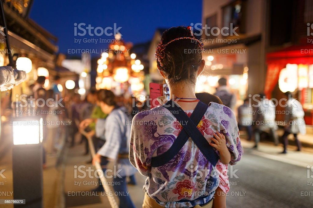 Mother and daughter is on street at Narita Gion Festival stock photo