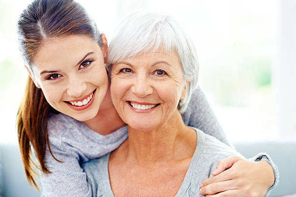 mother and daughter likeness - granddaughter and grandmother stock photos and pictures