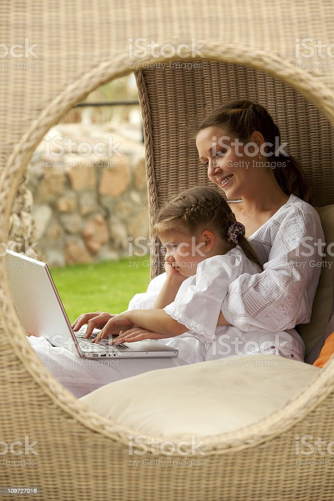 Mother and Daughter Looking at Laptop royalty-free stock photo