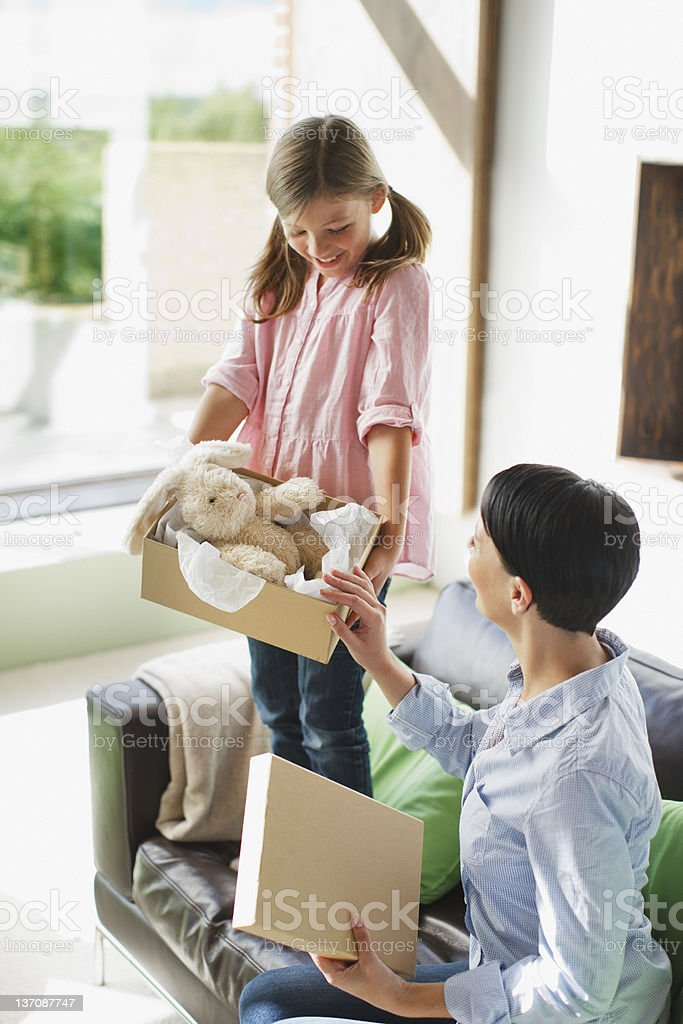 Mother and daughter looking at stuffed animal stock photo