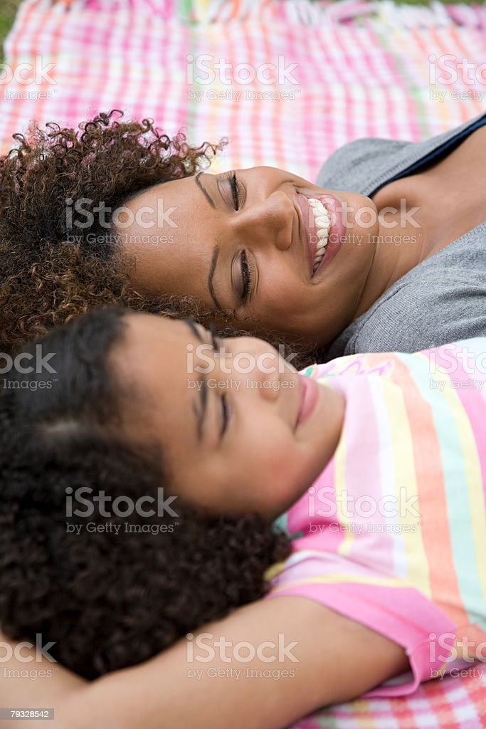 Mother and daughter lying on blanket royalty-free stock photo