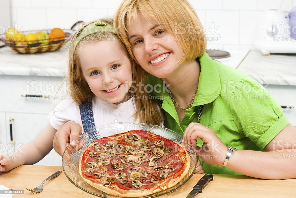 Mother and daughter made pizza at home royalty-free stock photo