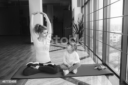 istock Mother and daughter makeing yoga 467733458