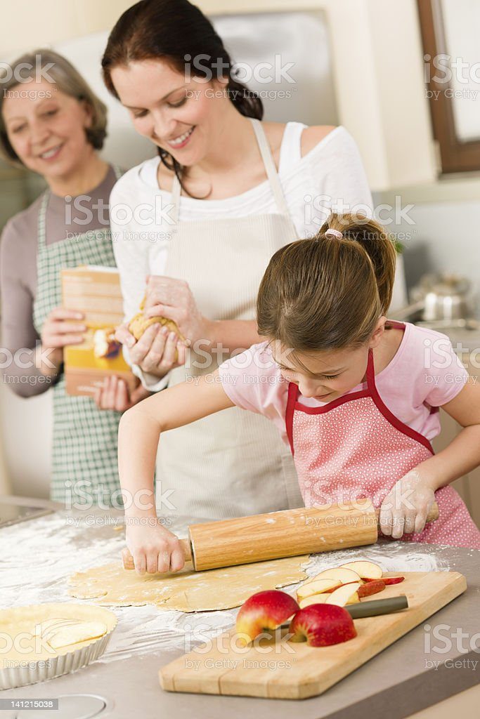 Mother and daughter making apple pie together royalty-free stock photo
