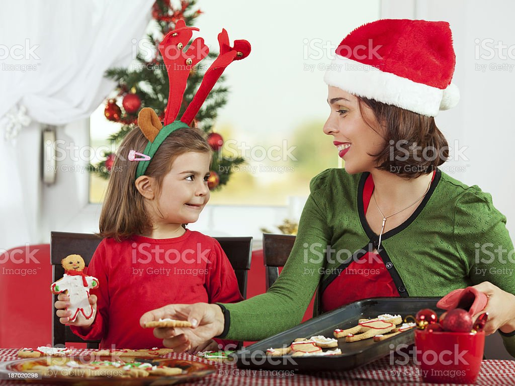 Mother and daughter making Gingerbread cookies royalty-free stock photo