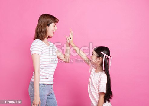 mother and daughter making hi five gesture