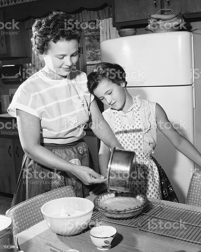 Mother and daughter making pie royalty-free stock photo