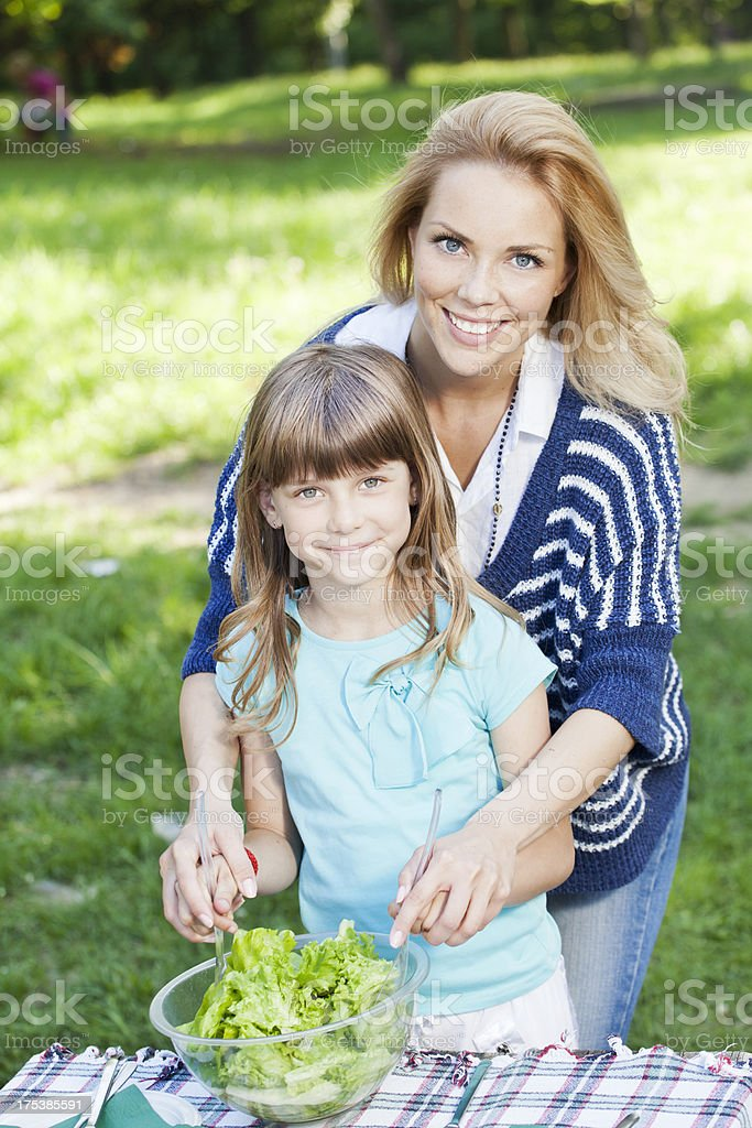 Mother and daughter making salad royalty-free stock photo