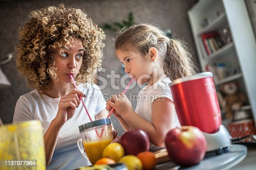 Mother and daughter making  smoothie
