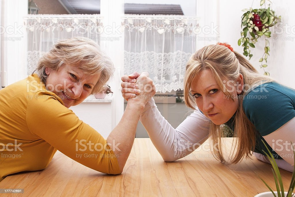 mother and daughter measure the forces royalty-free stock photo