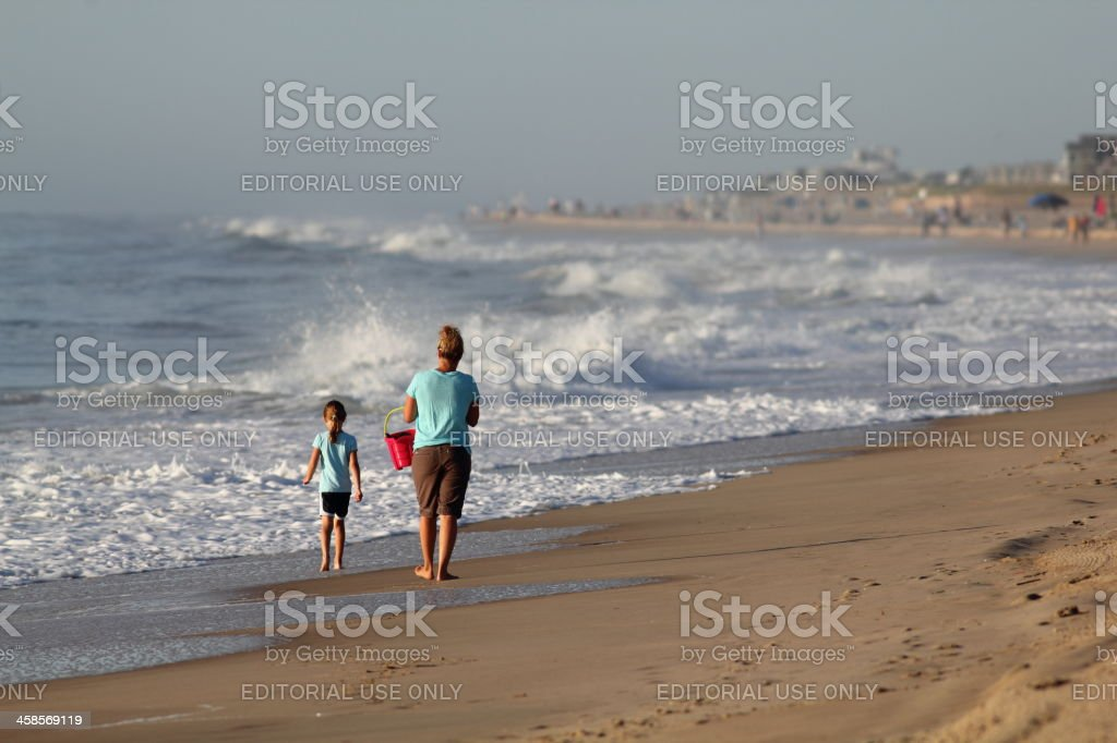 Mother and daughter morning walk stock photo