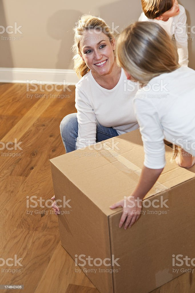 Mother and daughter moving box stock photo