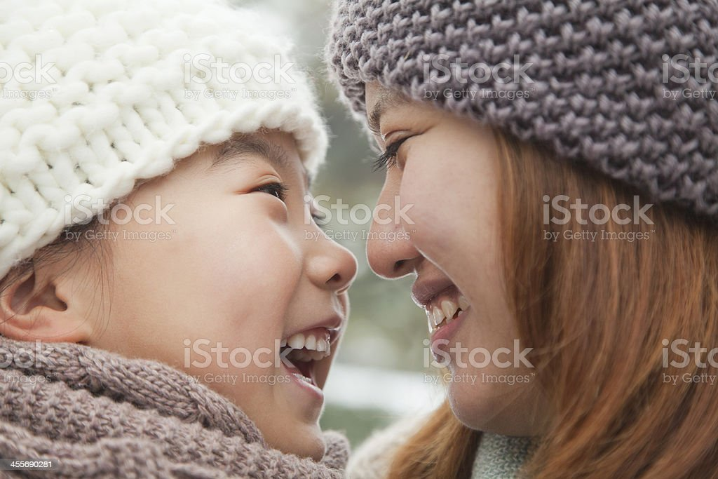 Mother and daughter nose-to-nose portrait stock photo