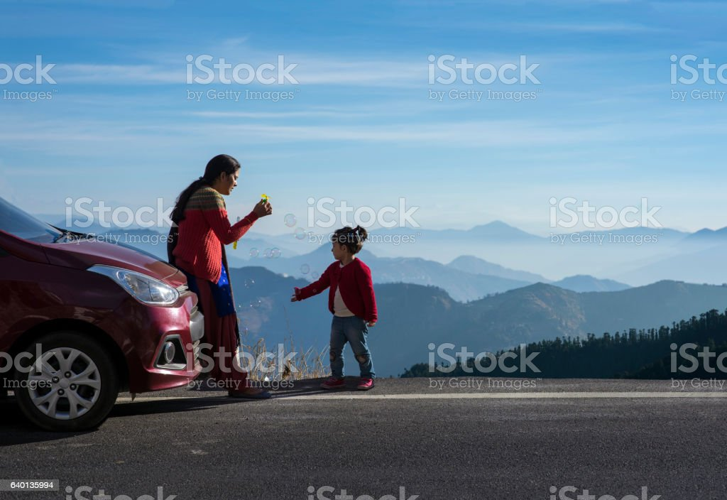 Mother and daughter on a road trip. stock photo