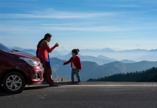 mother and daughter on a road trip. - asian travel in car stock photos and pictures