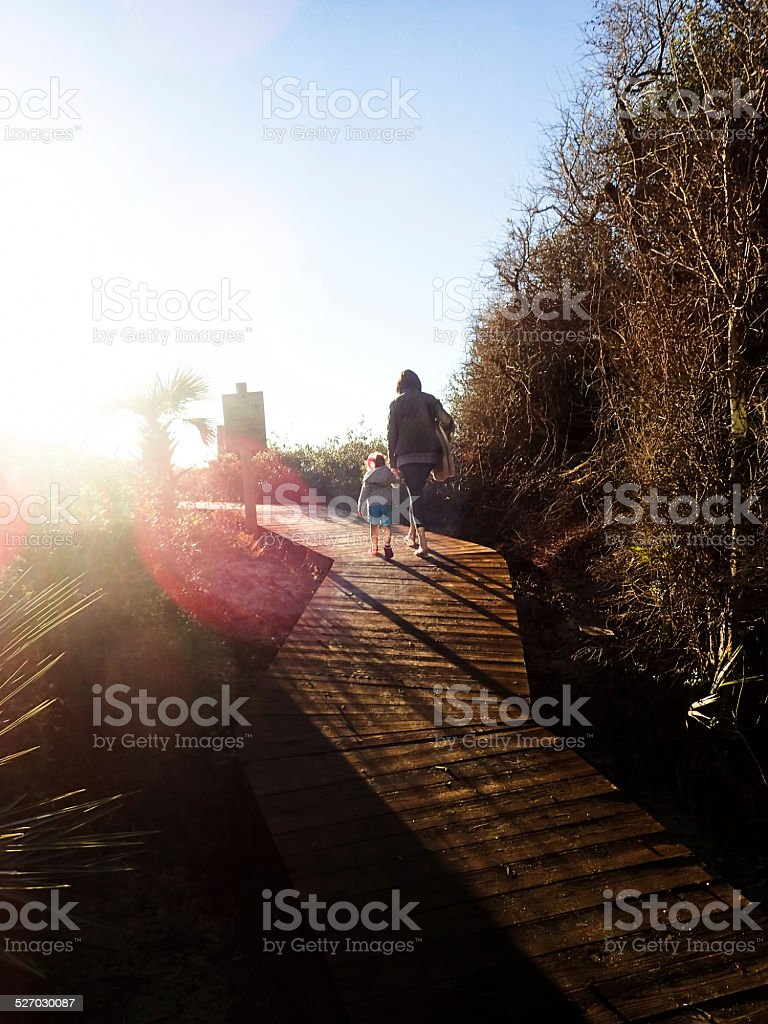 Mother and Daughter on Boardwalk in Kiawah Island, S.C. stock photo