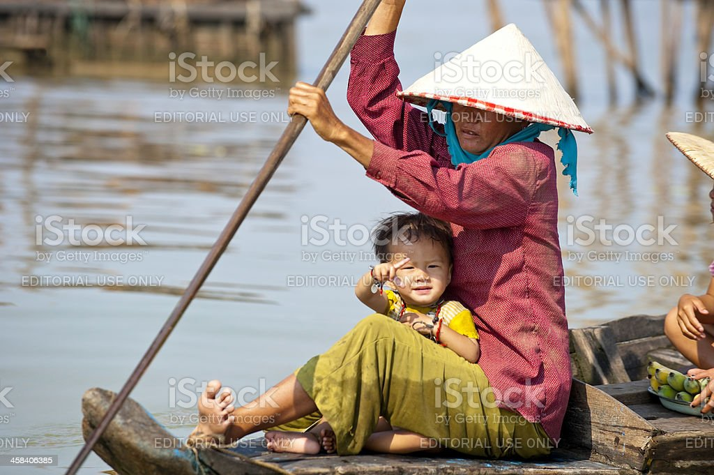 Mother and daughter on boat stock photo