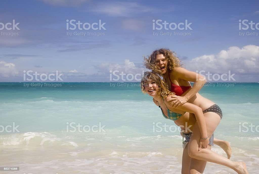 Mother and daughter on Hawaiian Beach royalty-free stock photo