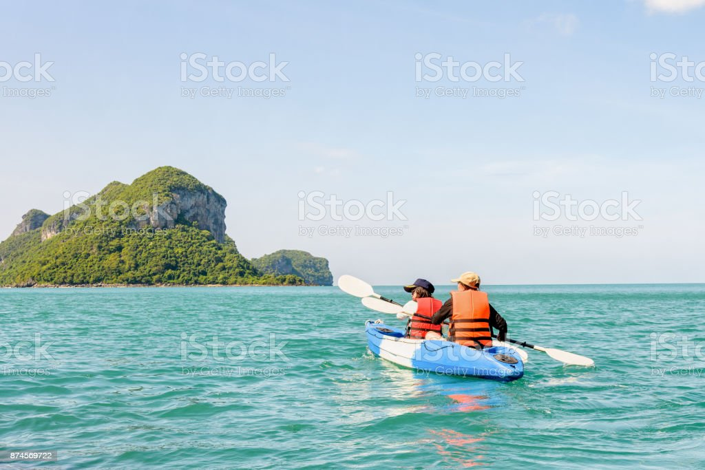 Mother and daughter on kayak stock photo