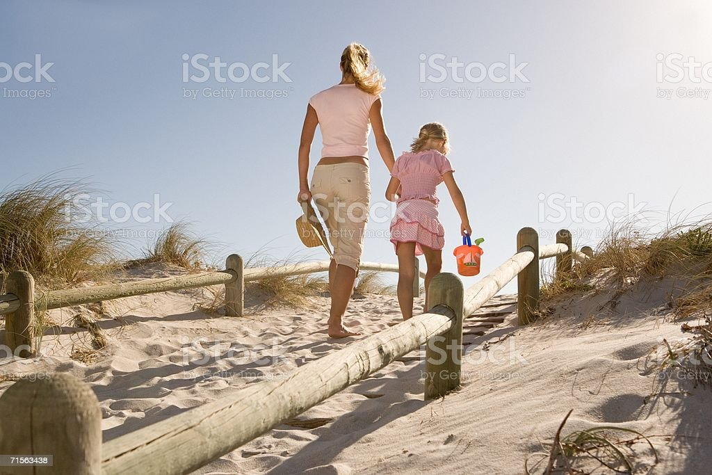Mother and daughter on sand dune royalty-free stock photo