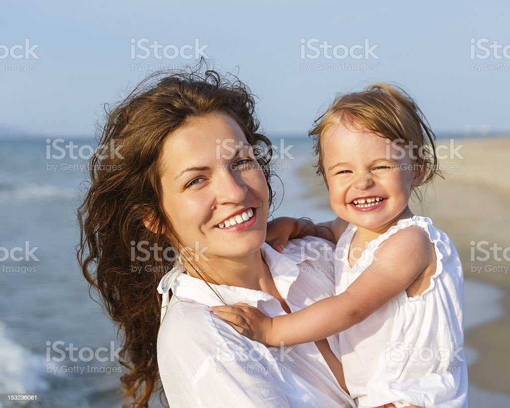 Mother and daughter on the beach royalty-free stock photo
