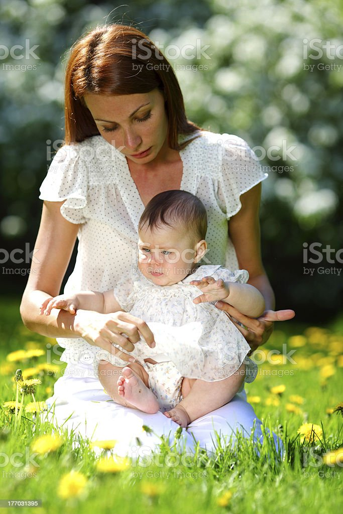 Mother and daughter on the green grass royalty-free stock photo