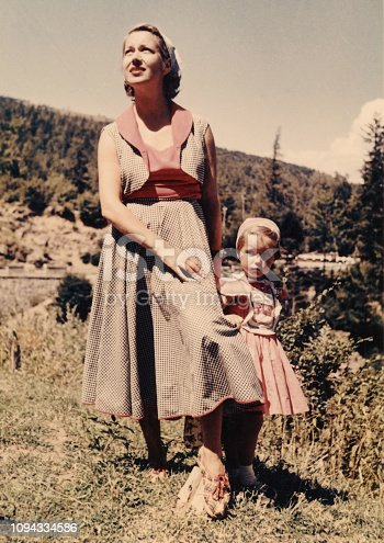 Mother and daughter on vacation in mountain,1952 Dolomites alps