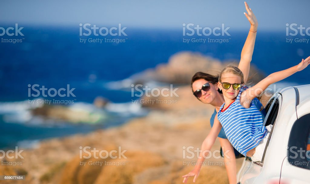 Mother and daughter on vacation travel by car. Summer holiday and car travel concept. Family travel. stock photo
