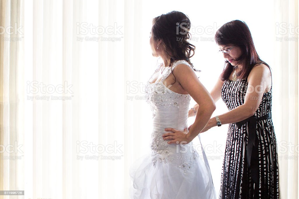 Mother and daughter on wedding day. stock photo