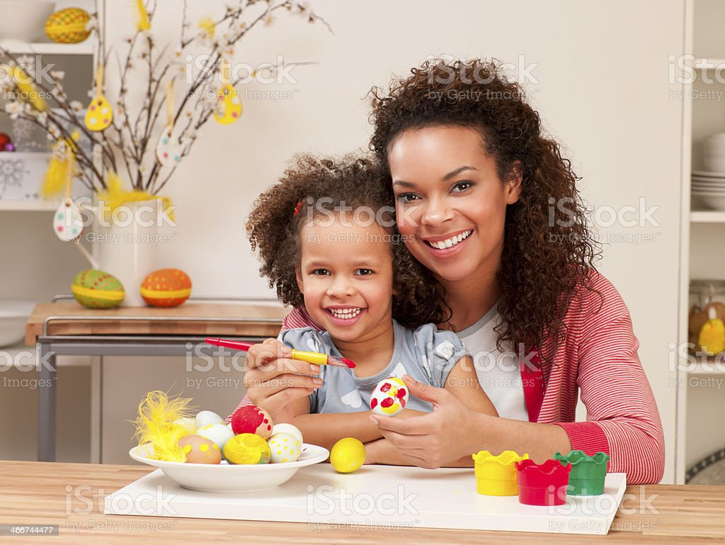 Mother and Daughter Painting Easter Eggs royalty-free stock photo