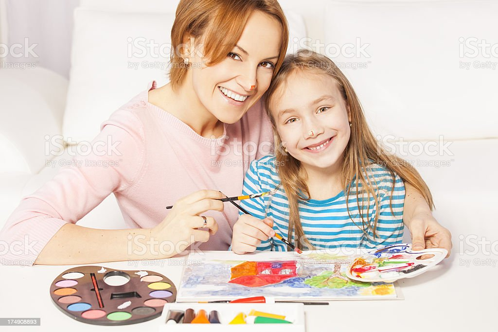 Mother and daughter painting royalty-free stock photo