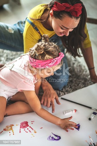 Mother and daughter painting together