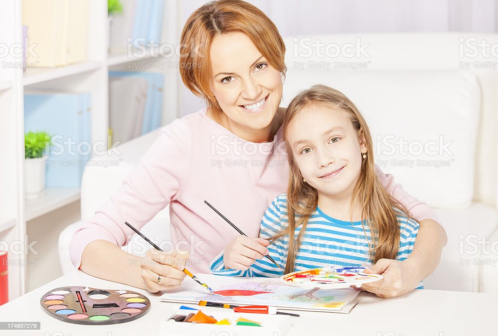Mother and daughter painting together royalty-free stock photo