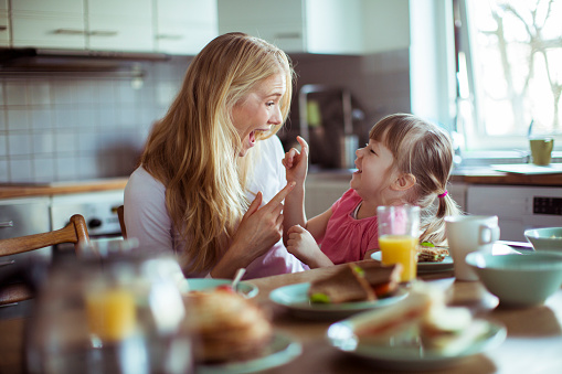 Close up of a mother and daughter having breakfast