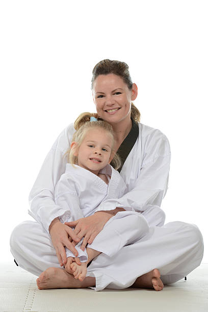 mother and daughter - martial arts gerville stock pictures, royalty-free photos & images