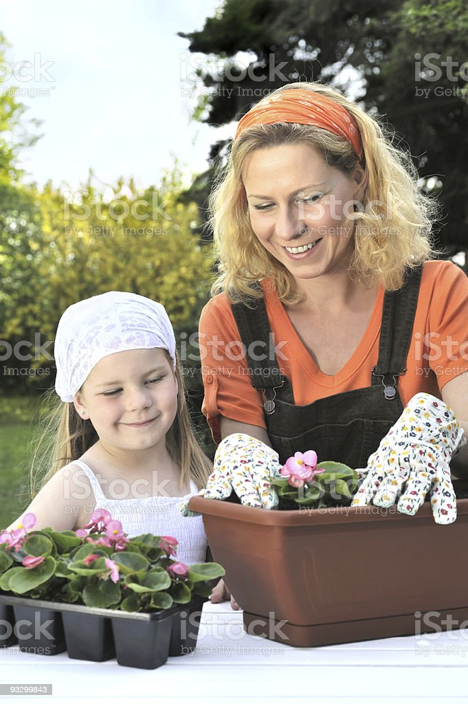 Mother and daughter planting flowers royalty-free stock photo