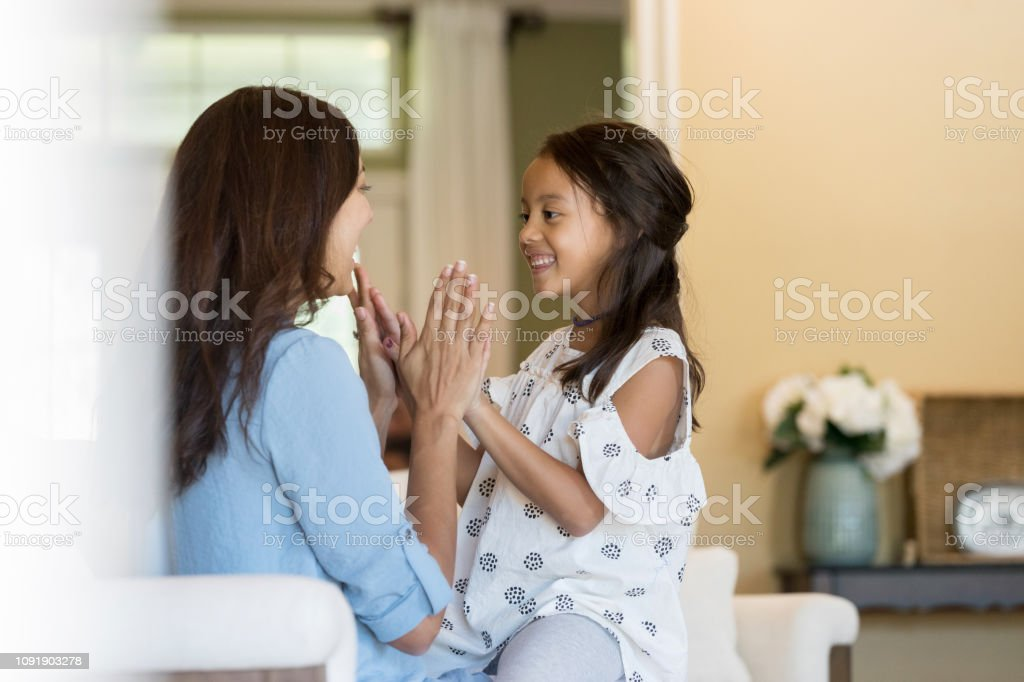 Mother And Daughter Play Clapping Game At Home Stock Photo Download Image Now Istock