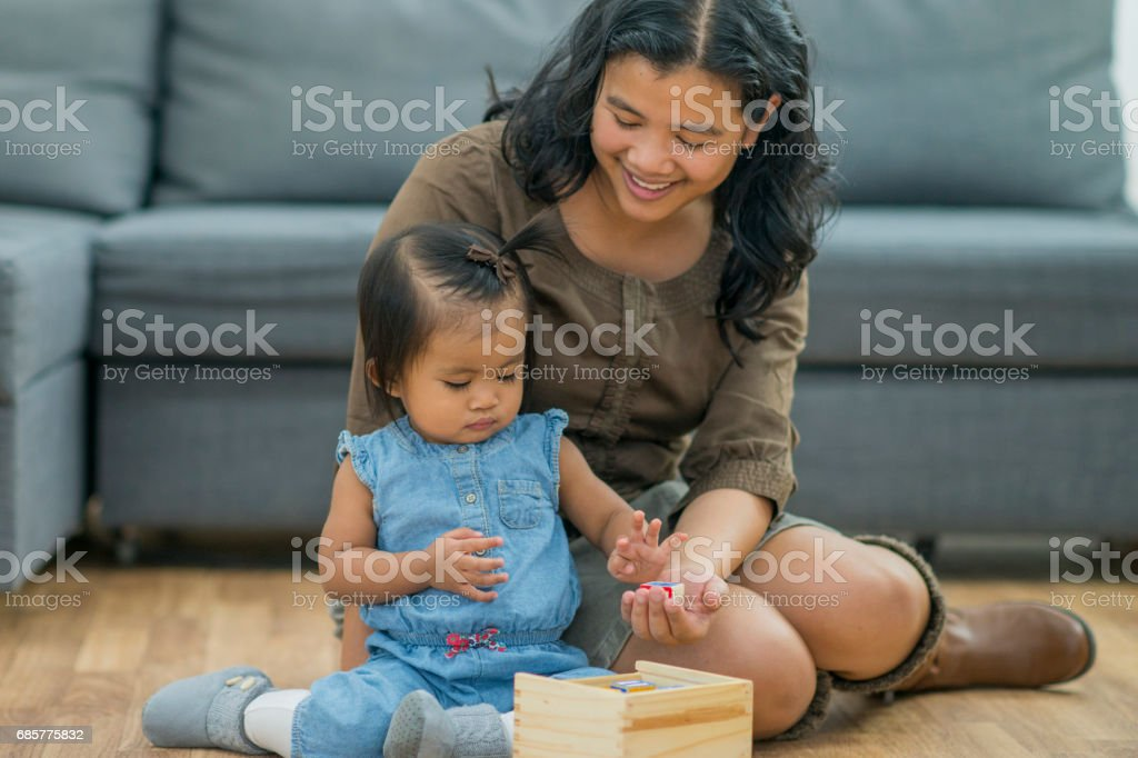 Mother and Daughter Play Together royalty-free stock photo
