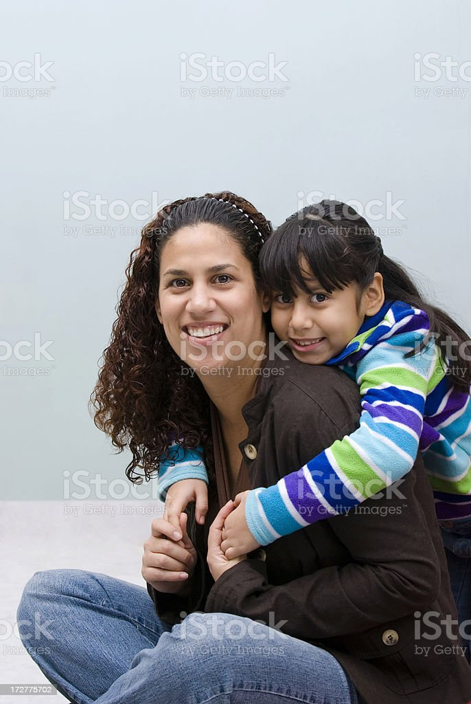 Mother and daughter playing affectionately royalty-free stock photo