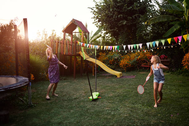 mother and daughter playing badminton in backyard - badminton sport stock pictures, royalty-free photos & images