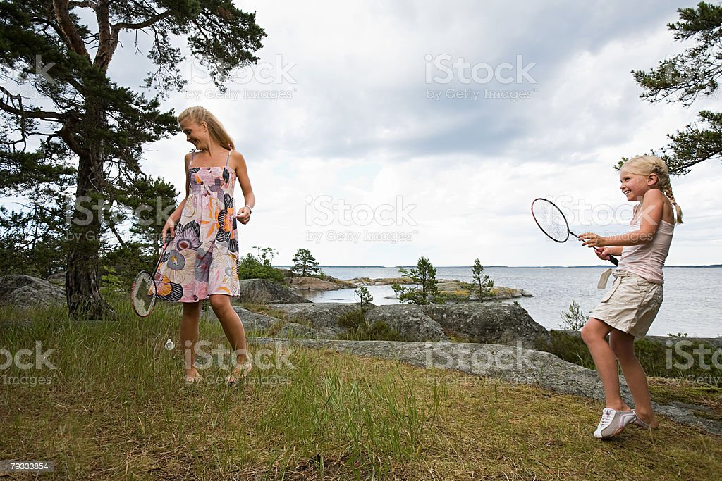 Mother and daughter playing badminton royalty-free stock photo