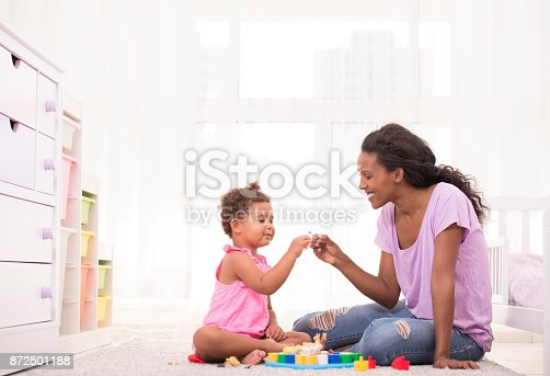 istock Mother and daughter playing educational game. 872501188